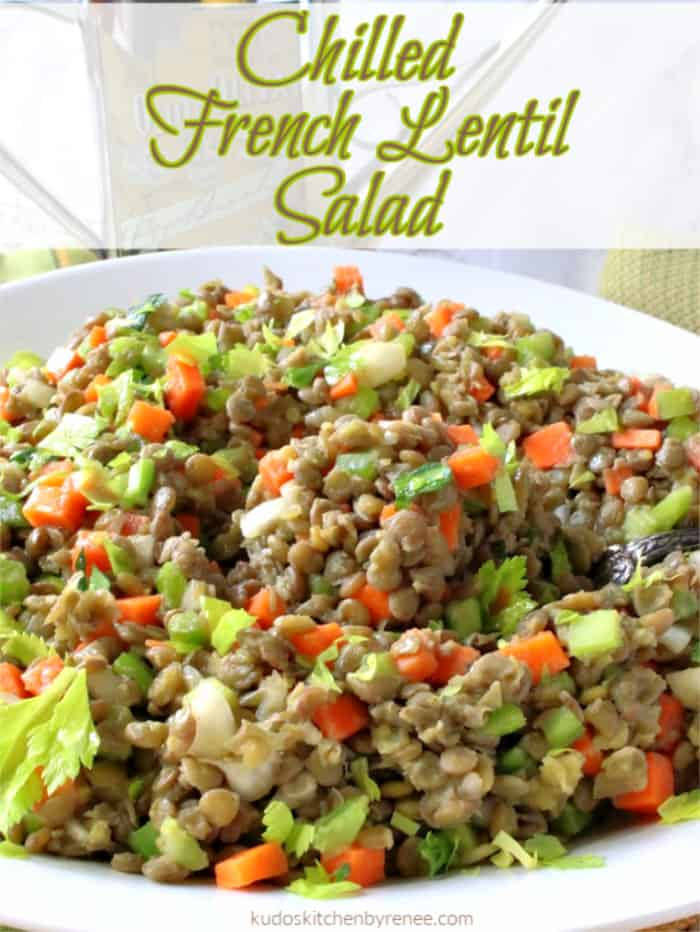 A colorful closeup photo of a French lentil salad with carrots, celery, shallots with title text.