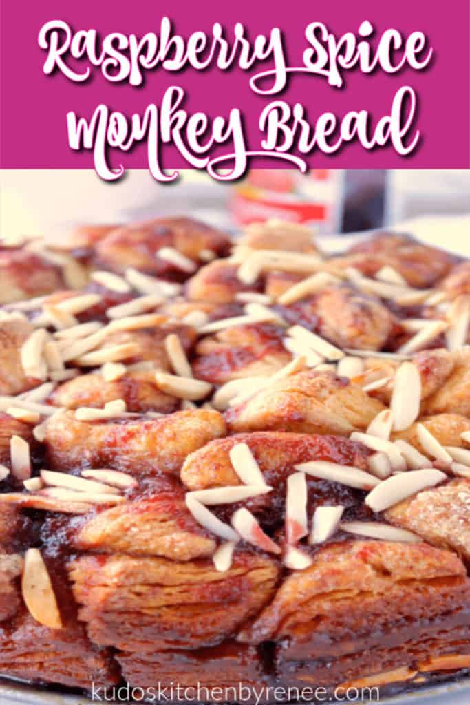 Closeup vertical photo of raspberry spice monkey bread with slivered almonds.