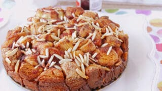 A round Raspberry Spice Monkey Bread on a square white plate.