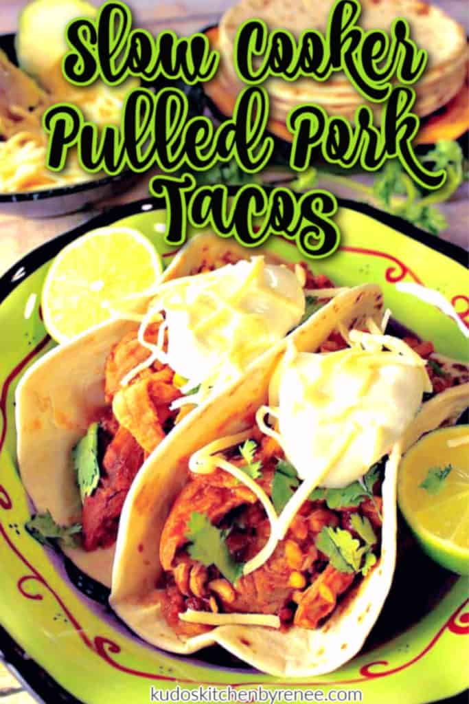Closeup photo of two slow cooker pulled pork tacos in a colorful bowl with title text overlay graphic.