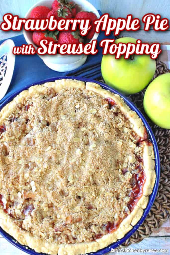 An overhead vertical photo of an entire strawberry apple pie with streusel topping and title text overlay graphics.