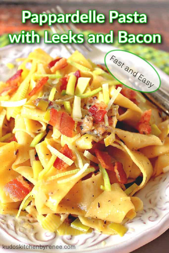 A closeup vertical photo of pappardelle pasta with leeks and bacon with title text overlay graphic