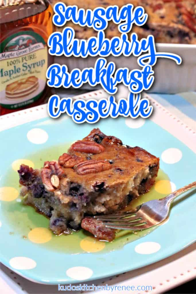 A closeup vertical title text graphic overlay image of a sausage blueberry breakfast casserole slice on a blue and white plate with pecans, maple syrup, and a fork.