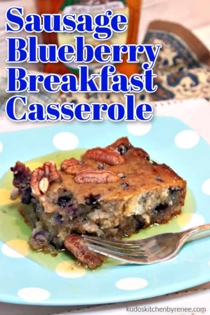 A vertical title text overlay graphic for a slice of sausage blueberry breakfast casserole on a blue polka dot plate