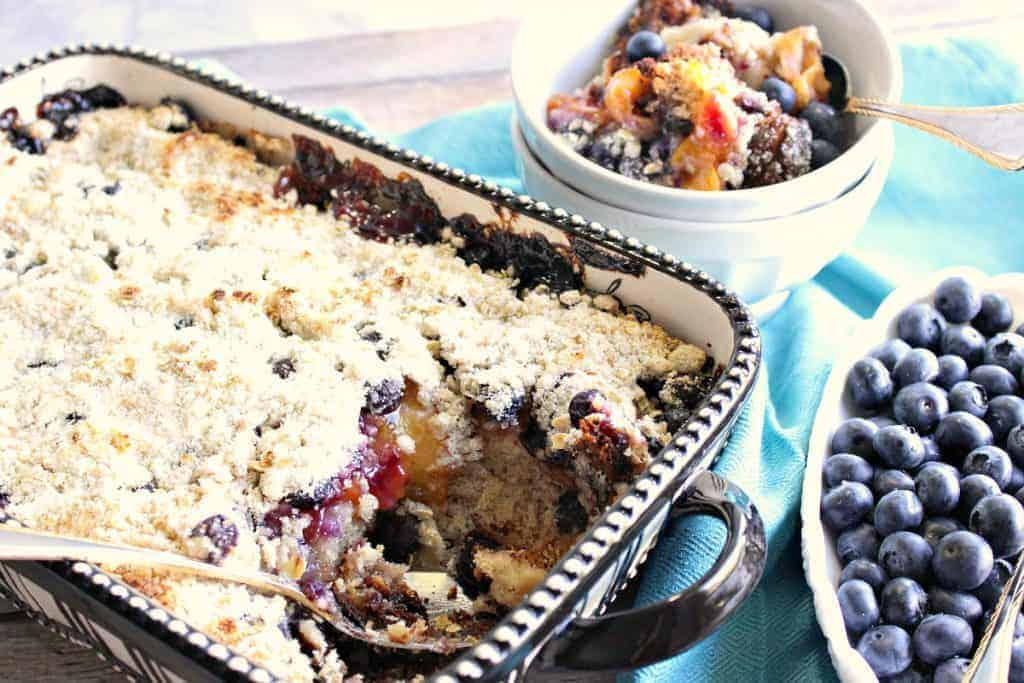 A 9 x 13 baking dish filled with peach and blueberry crisp