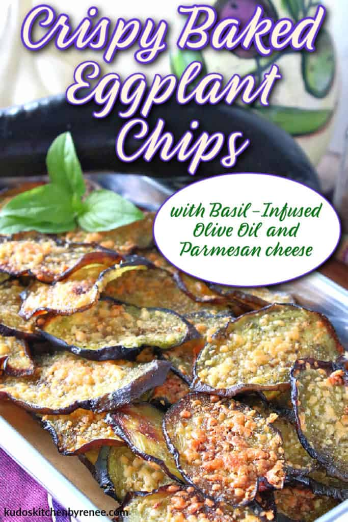 A vertical image of crispy baked eggplant chips on a small baking tray with a whole eggplant in the background and a title text overlay graphic in purple and white
