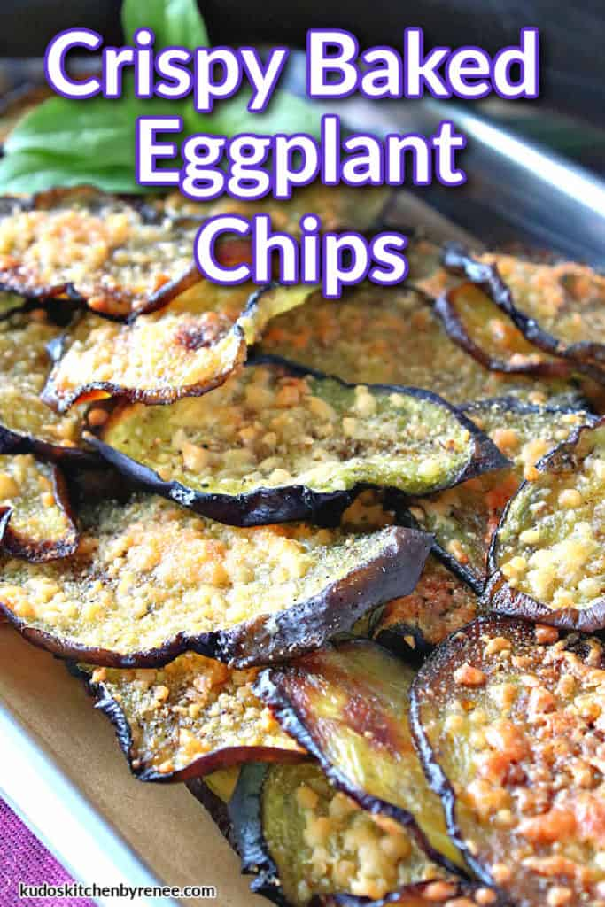 A vertical closeup of a small baking tray piled high with crispy baked eggplant chips and a title text overlay graphic in purple and white.