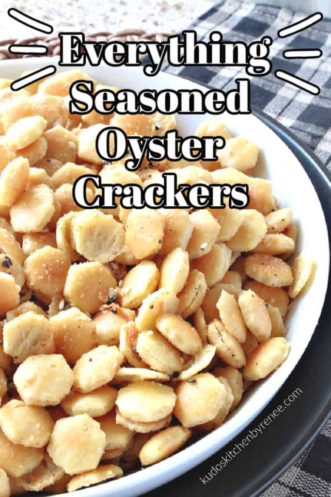 A vertical closeup inage of a bowl of everything seasoned oyster crackers with a black and white title text graphic overlay