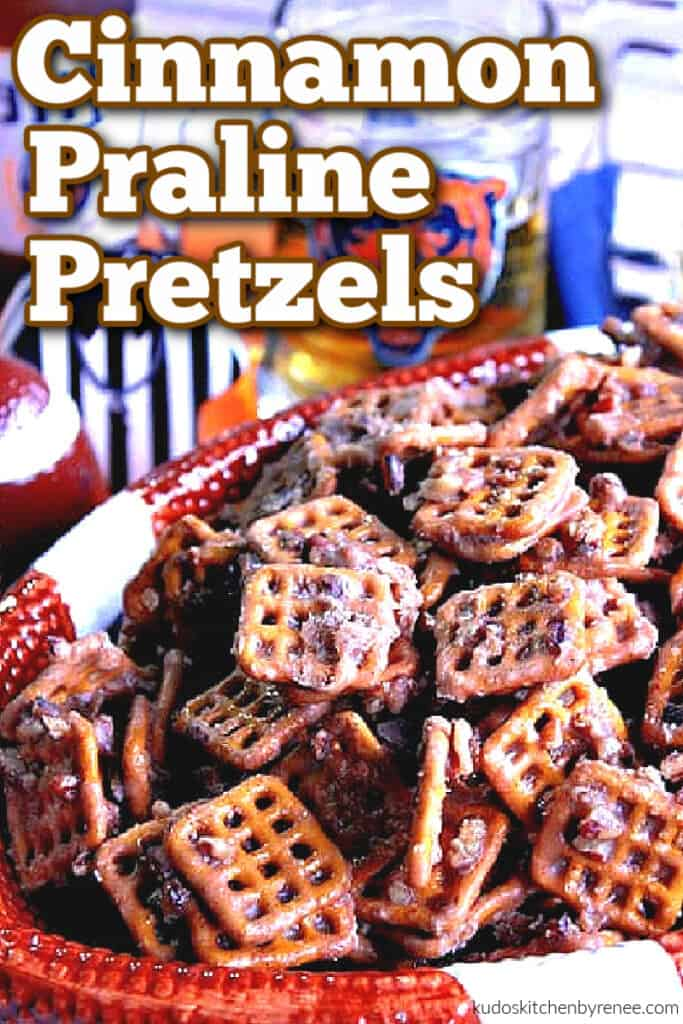 A vertical closeup image of Cinnamon Praline Pretzels in a football bowl with a title text overlay graphic