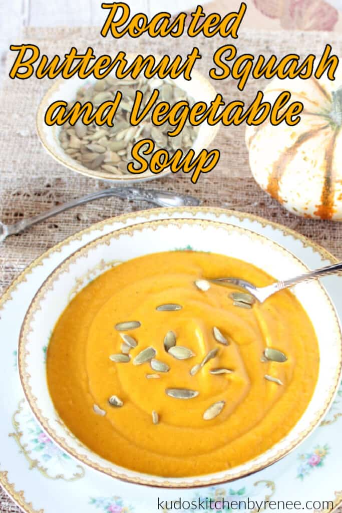 Extreme closeup of a bowl of Roasted Butternut Squash Soup with a title text overlay graphic in yellow and black