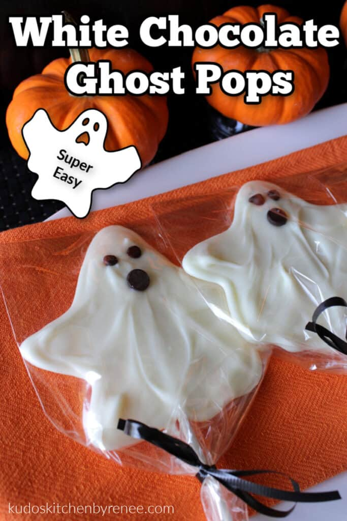 A vertical closeup of two white chocolate ghost pops on an orange napkin with pumpkins and a title text overlay graphic