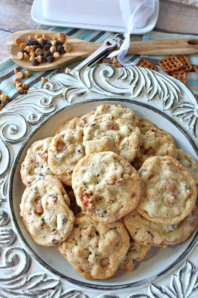 A vertical overhead image of a plate of Take 5 Cookies with pretzels and chocolate chips.