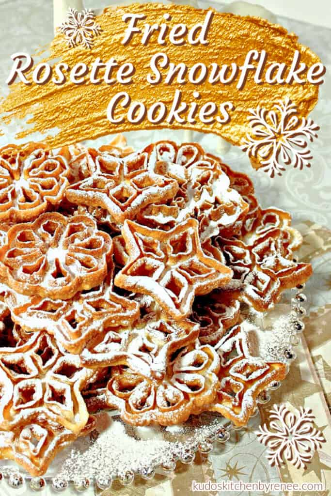 Vertical closeup image of Rosette Snowflake Cookies with confectioners sugar dusting and a title text overlay image in gold and white.