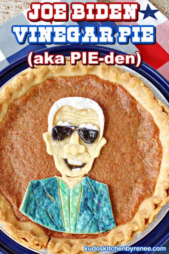 An overhead vertical closeup of a vinegar pie with a Joe Biden character painted pie crust on top.