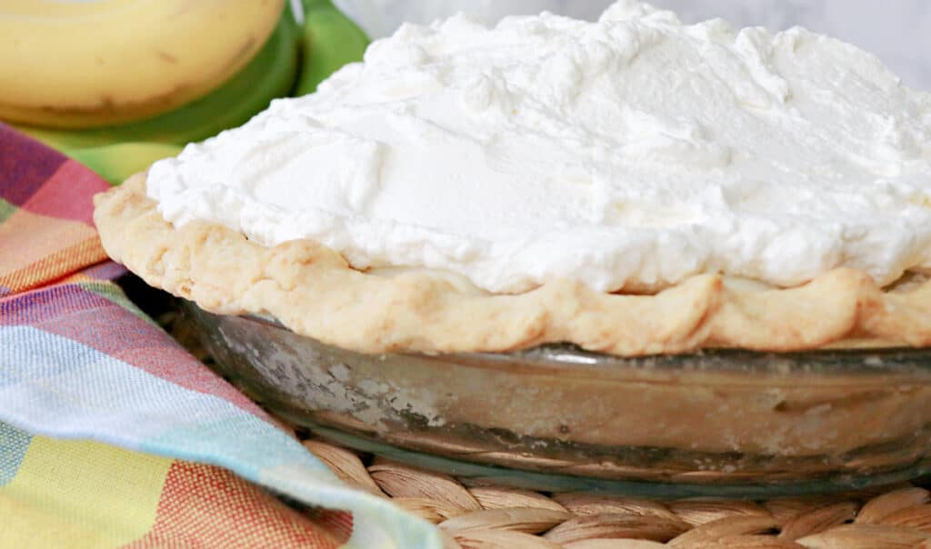 When dessert calls for something truly special, break out this recipe for Mom's Best Banana Cream Pie, and you won't be sorry! #pie #bananapie #bananacreampie #creampie #homemadepiecrust #bananadessert #bananas #homemadewhippedcream #kudoskitchenrecipes