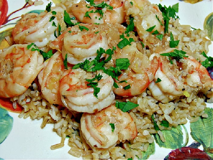 Skinny Shrimp Scampi on a colorful plate with parsley and brown rice.