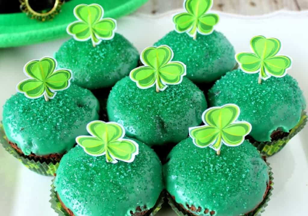 A super close image of Chocolate Mint Brownie Cupcakes with green icing and green sanding sugar.