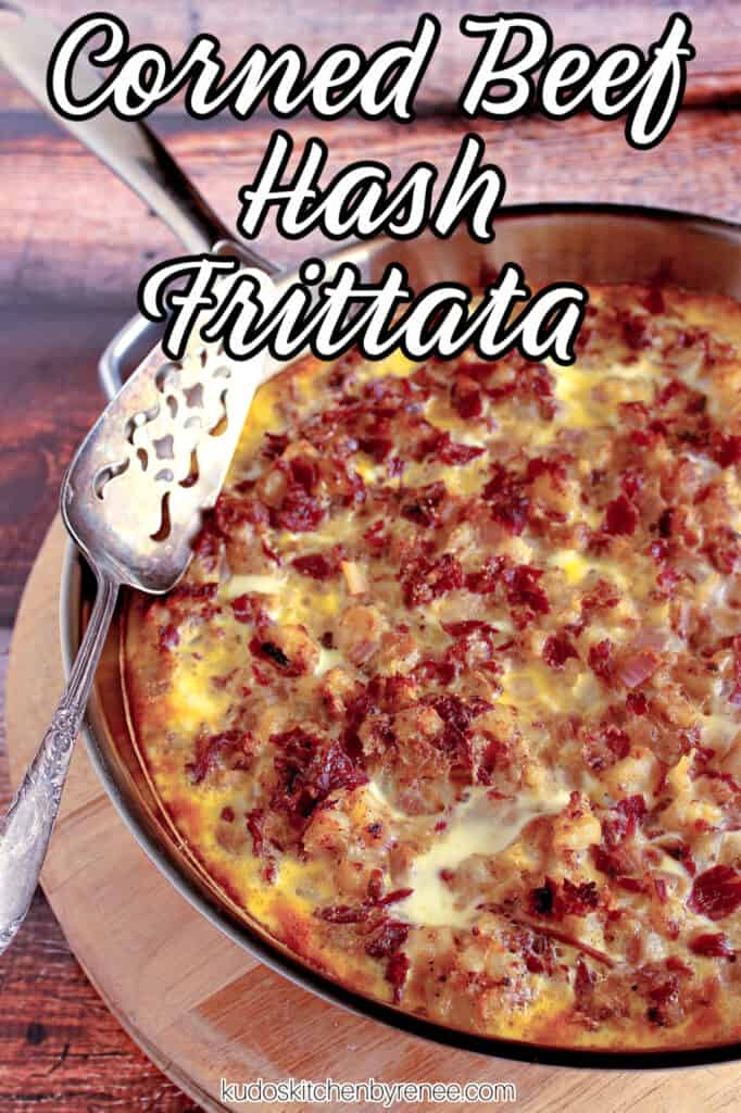 A vertical closeup with a title text overlay graphic for a Corned Beef Hash Frittata in a silver skillet with a silver pie server.