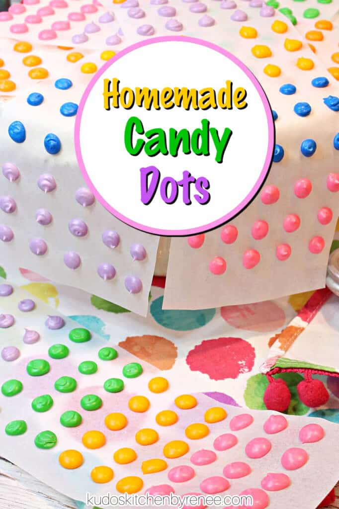 A vertical closeup of colorful retro Homemade Candy Dots on white strips of paper with a colorful title text overlay circle.
