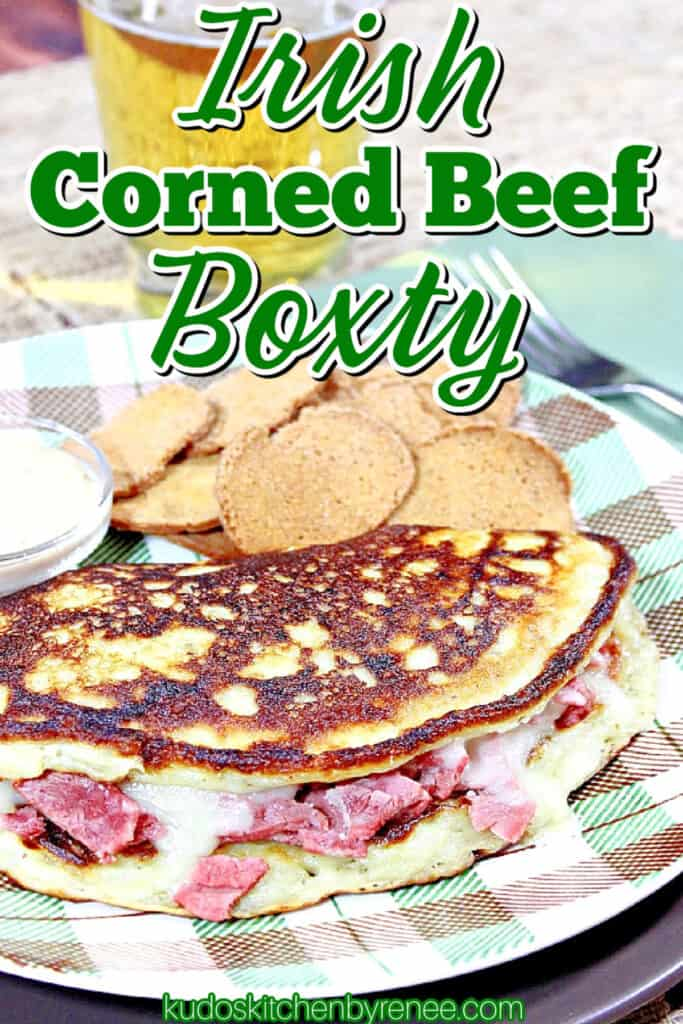 A closeup vertical title text image for Irish Corned Beef Boxty potato pancake with melted cheese and corned beef.