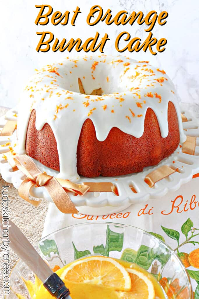 A vertical closeup photo of an Orange Bundt Cake on a white cake stand with an orange ribbon along with a title text overlay graphic.