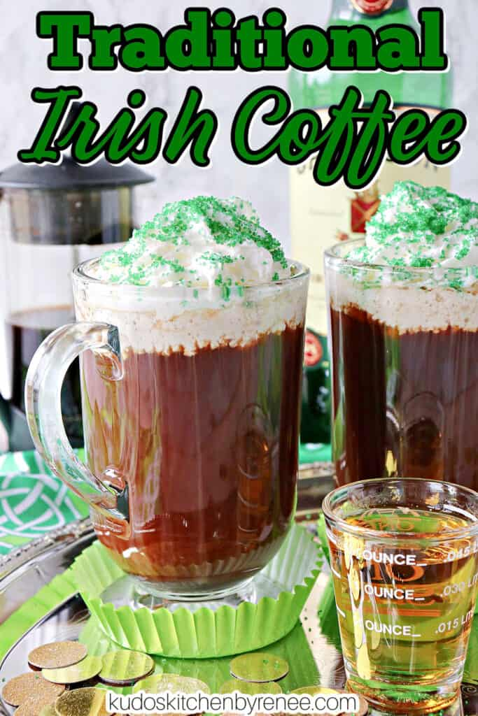 A vertical closeup of a mug of Irish Coffee with whipped cream and green sugar along with a title text overlay graphic.