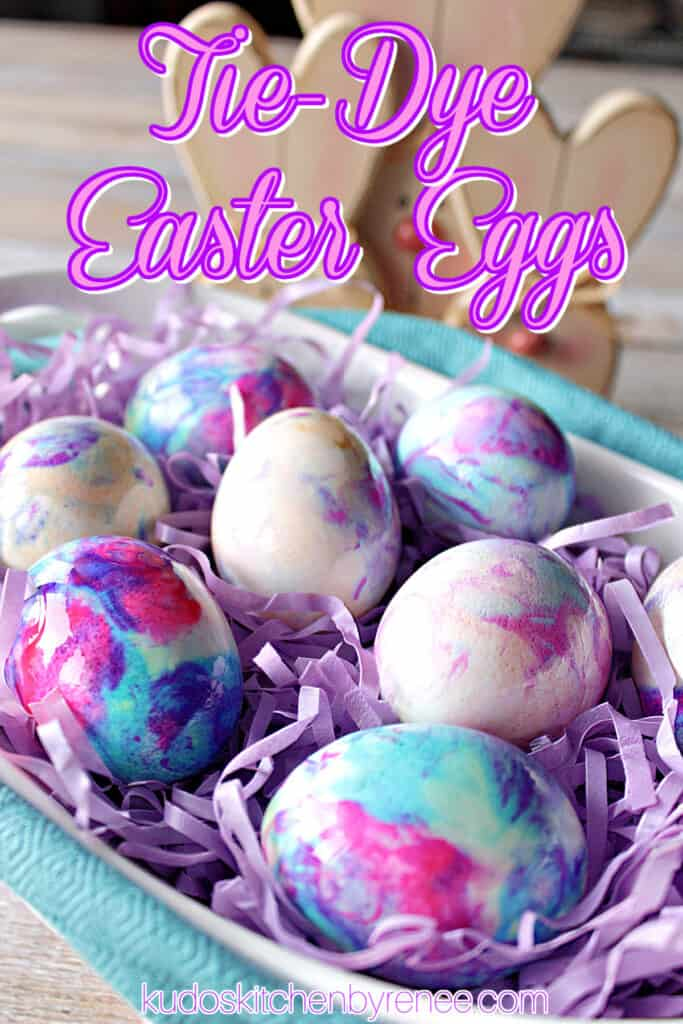 A vertical closeup photo along with a title text overlay graphic for Tie-Dye Easter Eggs with pretty marbled colors.