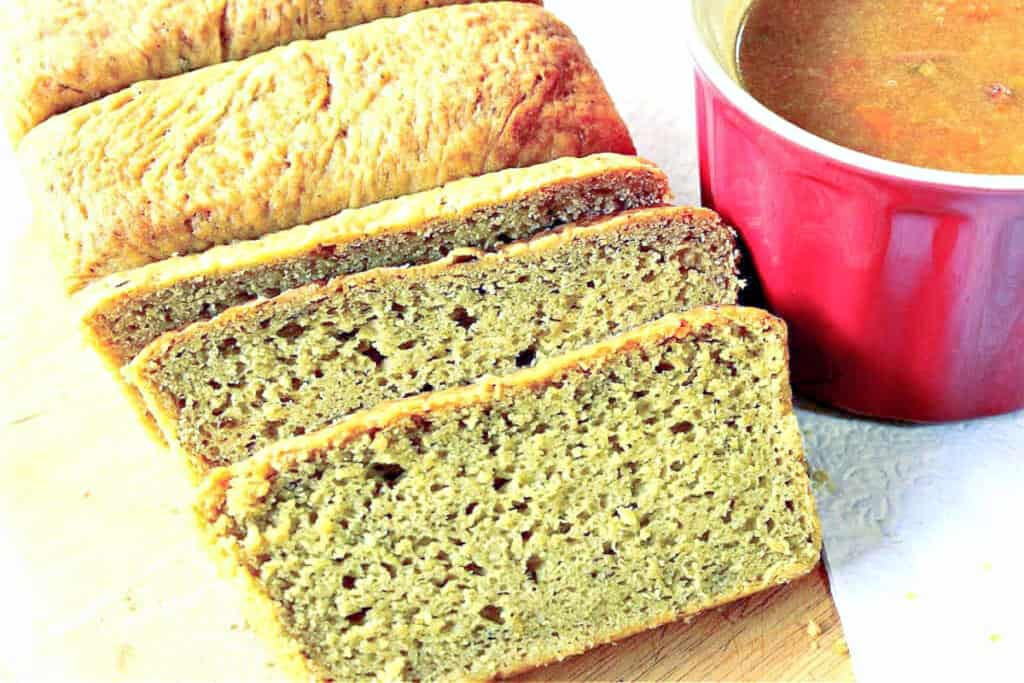 A horizontal photo of a sliced loaf of Avocado Yeast Bread with a mug of soup on the side.