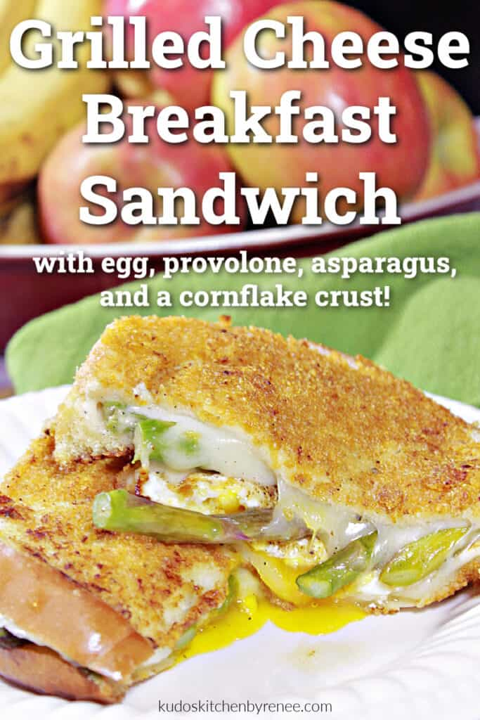 A vertical closeup image of a sliced in half Grilled Cheese Breakfast Sandwich along with a title text overlay graphic.