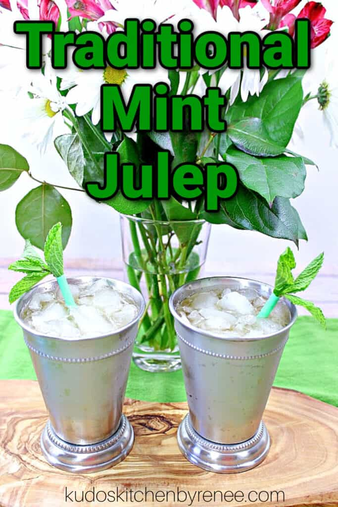 A vertical closeup of two glasses of Traditional Mint Juleps in metal glasses along with a title text overlay graphic.