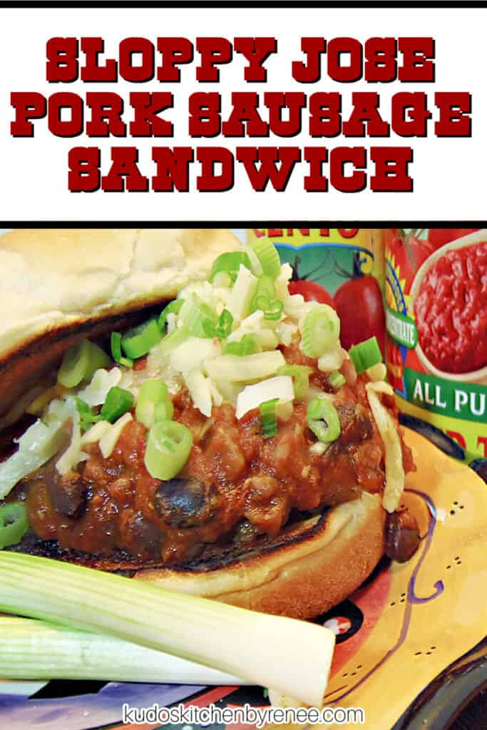 A closeup vertical image along with a title text overlay graphic of a Sloppy Jose Pork Sausage Sandwich with chopped scallions.