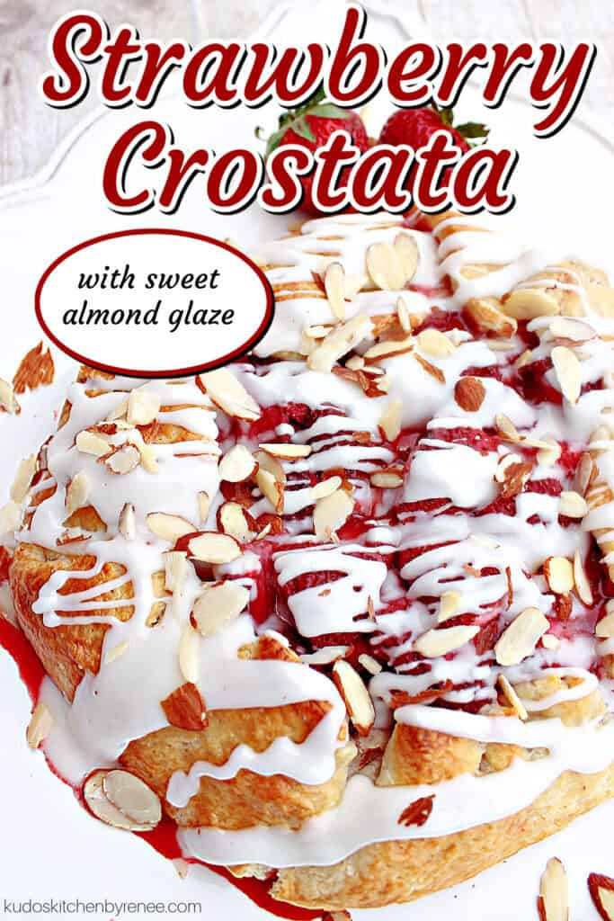 A vertical title text closeup image of a Strawberry Crostata with a Sweet Almond Glaze topped with sliced almonds.