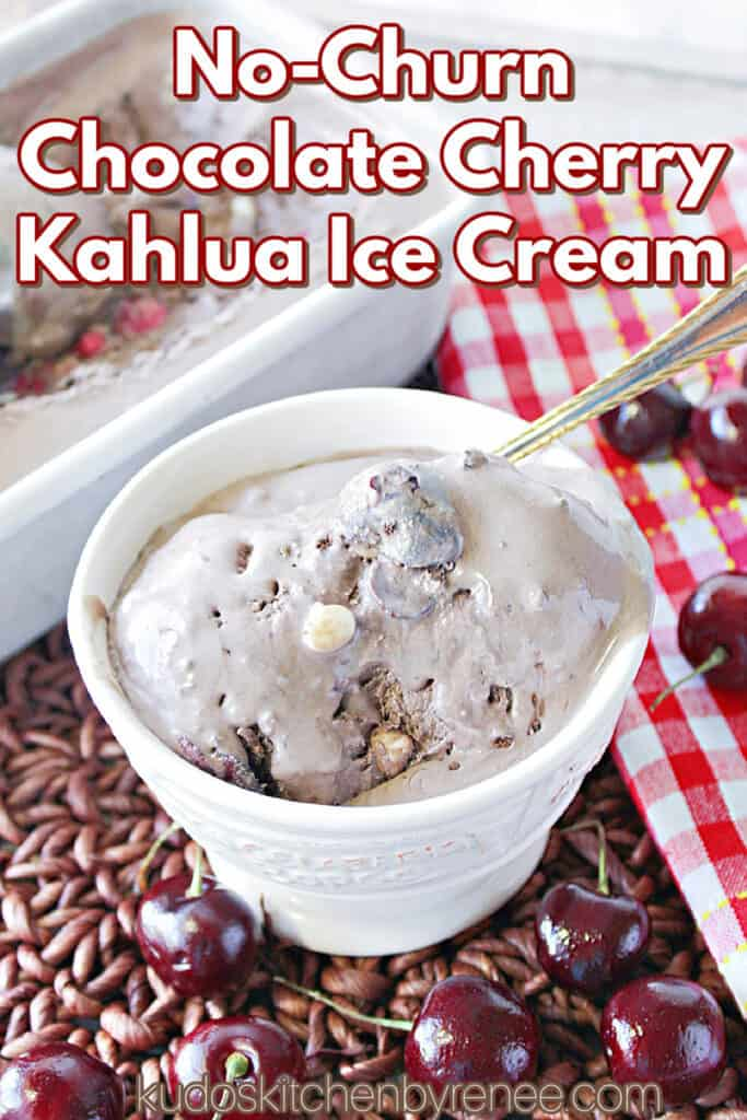 A vertical closeup image along with a title text overlay graphic for Chocolate Cherry Kahlua Ice Cream with a spoon and fresh cherries on the table in front of the dish.