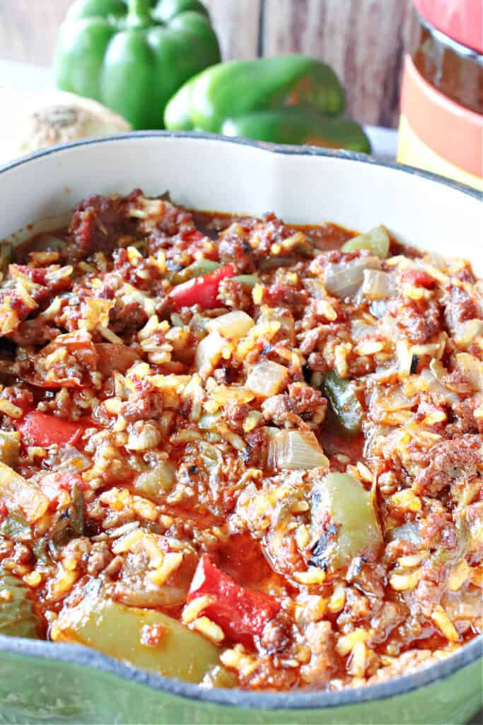 A closeup vertical image of a big pot of Stuffed Green Pepper Stew with ground beef, onion, and rice.