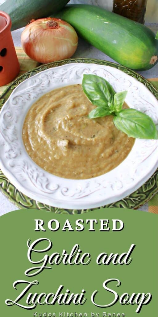 A vertical image along with a title text overlay graphic for Roasted Garlic and Zucchini Soup with fresh basil as garnish.